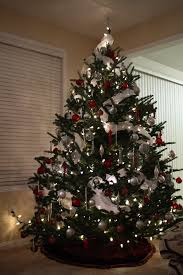 Decorating Christmas Tree With Balls White And Red Christmas Decoration Showing Green Christmas Tree 16