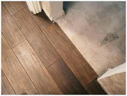 vinyl over tile wood floor over tile vinyl plank flooring tile look can you install vinyl