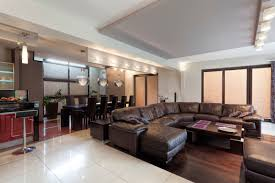 Large living room with over-sized sectional sofa and bar