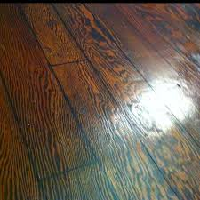 tore out the carpet sanded and stained the plywood suloor used a sharpie pen for the lines and rolled over that with a cutter