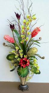 tropical large floral arrangement designed by arcadia floral