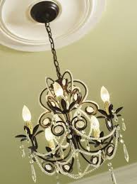 iron chandelier with cream colored ceiling medallion