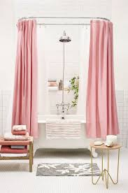 pink curtains can easily turn any usual bathroom into a feminine one