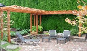 Decoration, Adorable Wooden Pergola Roof Cover Over Black Iron Relaxing  Chairs On Backyard Pavers As Well As Pine Trees As Decorate In Easy Patio  Ideas ...