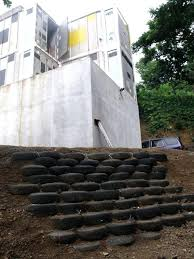 tire retaining walls we are also building a tire wall in front of the house to