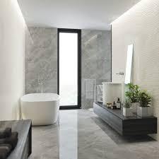 large wall tiles light grey bathroom