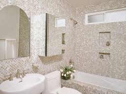 neutral floor to ceiling mosaic tiles covering bathroom walls and bathtub
