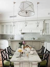 Elegant eat-in kitchen photo in Moscow with glass-front cabinets, white  cabinets