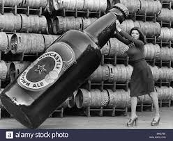 Janette Harper with a Giant Newcastle Brown Ale Bottle 1977 Stock Photo -  Alamy
