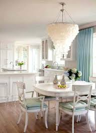 large capiz shell chandelier large shell chandelier over white dining table and chairs in chic dining