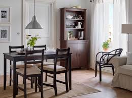 ikea furniture for small spaces. A Dining Room With Black-brown Table And Chairs Beige Seat Covers Ikea Furniture For Small Spaces