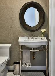 white porcelain washstand with two legs and gray sisal wallpaper