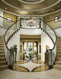 entry double stairway with star design on floor and modern chandelier
