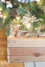 Rustic looking Christmas tree stand box. Grab some old 2x4s from your  basement and got started! Cut them in size and