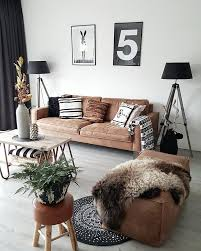 tan leather sofa with graphic art