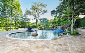 Patio with pool Outdoor Zeroentry Pool With Waterfall In Large Heavily Treed Backyard With Huge Surrounding Patio Patio Design 99 Swimming Pool Designs And Types 2019 Pictures