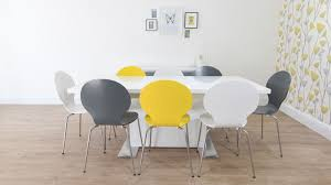 modern coloured dining chairs and white gloss extending dining table