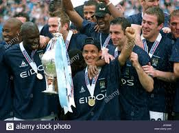 ALI BENARBIA & TEAM MATES MANCHESTER CITY DIV1 CHAMPIONS MAIN ROAD Stock  Photo - Alamy
