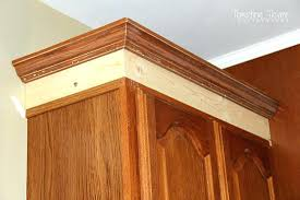 add molding to kitchen cabinets adding height to your kitchen cabinets with simple molding diy add
