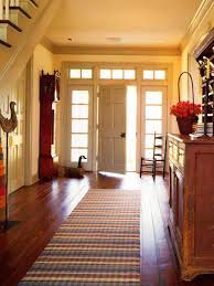 spacious foyer with storage and runner