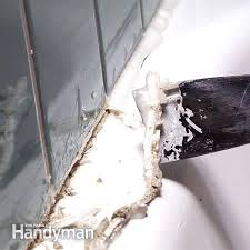 removing old bathtub caulk photo 2 remove the loosened caulk removing bathtub caulk mold removing shower removing old bathtub caulk