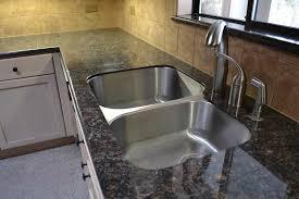 granite tile countertops with wood trim