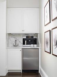 thermador coffee maker. kitchen with built-in coffee station boasting crisp white cabinets fitted a stainless steel mini fridge paired marble countertop and thermador maker