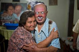 photos pitito s oldest clown com ricardo farfan pitito gets a hug from his wife maria munoz after