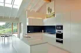 kitchen modern elegant white kitchen idea with dining area over crystal chandelier plus island bar