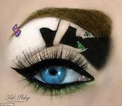 crown makeup on eyelid. the princes and frog eyelid design sees both protagonists pucker up - eyebrow used as crown makeup on