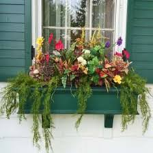 Decorative Window Boxes green winter window box with decorative flower arrangement 32