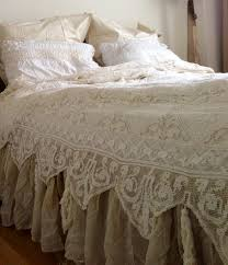 lace coverlet over natural linen dust ruffle coverlet maybe a curtain panel