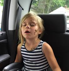 Sister snack Teen spits sunflower seeds out of the car window.