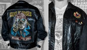 black leather biker jacket with hand engraved eagle and pyramid studs