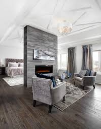 floor to ceiling fireplace bedroom transitional with coffered ceiling  upholstered headboards
