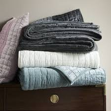 for a cozy winter bed add a luxe layer of quilted velvet in dusty