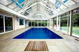 Cool Modern Indoor Swimming Pool Decor With Ceramic Floor And Brick Wall  Also Large Glass Sliding ...