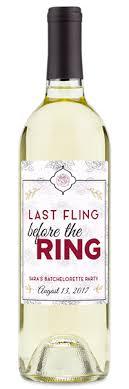custom labeled last fling before the ring on a white wine bottle