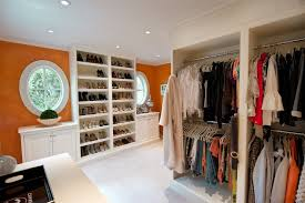 standing closet rack with traditional closet and carpeting orange recessed lights round window shoe shoe shelves walk iin closet white white painted wood