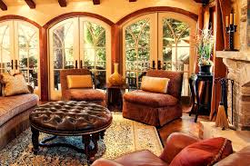 round leather ottoman living room rustic with arched windows area rug chenille sofa container plants decorative