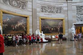 paintings of revolutionary period by john trumbull right general george washington resigning his commission left surrender of lord cornwallis