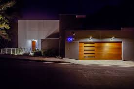 garage door repair raleigh nc contemporary exterior and bridge entry dramatic lighting drivewya flat roof garage door glass panel door gray siding house