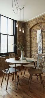 a simple sophisticated design the niklas dining table teams a clic round shape with hairpin legs for a pared back look with a hint of industrial style