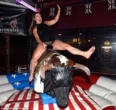 Nude girl riding a bucking bronco