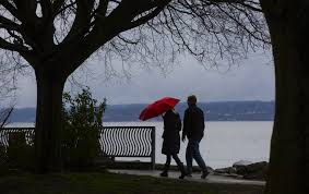 although the beach at golden gardens park is closed many beachcombers still walked along the