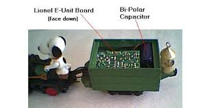 lionel reversing unit a bi polar capacitor for a handcar if room permits inside the ore car substitute bridges for power resistors in the first diagram on this page