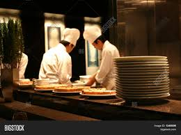 busy restaurant kitchen. Image Of Two Chefs Working In A Busy Restaurant Kitchen B