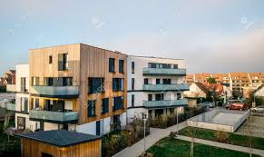 Modern Townhouses In A Residential Area With Multiple New Apartments Buildings Surrounded By Green Outdoor Facilities With Cars Parked On The Street Stock Photo, Picture And Royalty Free Image. Image 121713581.