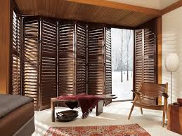 newstyle hybrid shutters with bi fold track system for sliding glass doors for