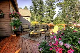 portland iron plant with woven outdoor rugs deck traditional and area rug decorative pillows